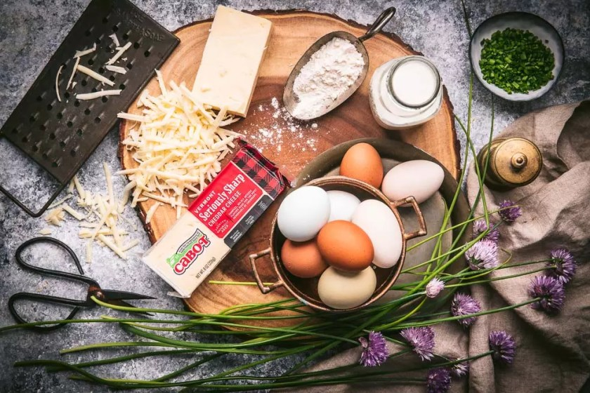 A platter of ingredients - eggs, cheese, milk and chives