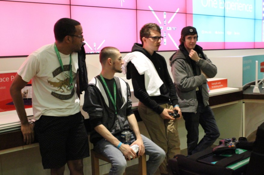 More attendees pass the time with CoD: Ghosts.