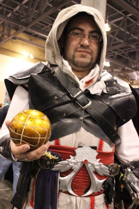 An Ezio Auditore cosplayer from Assassin's Creed II holds up his Apple of Eden. (Photo by Christen Bejar)