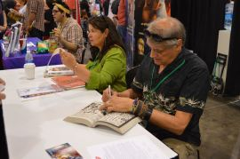 Herb Trimpe signing books for fans