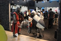 A young attendee duels the cosplayers at the Life is Feudal game booth.