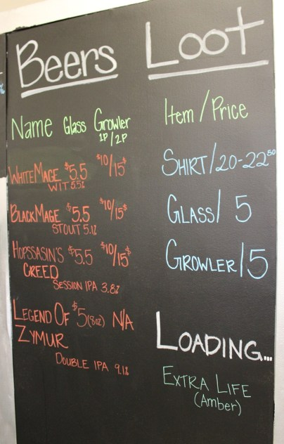 The beer menu along with upcoming 'Loading' brews and swag for purchase.