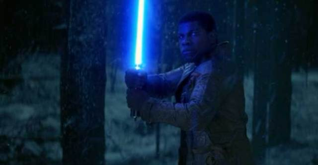 Finn with lightsaber in The Force Awakens