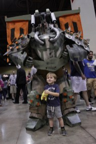 A massive Cabal cosplay from Destiny dwarfs this young gamer.