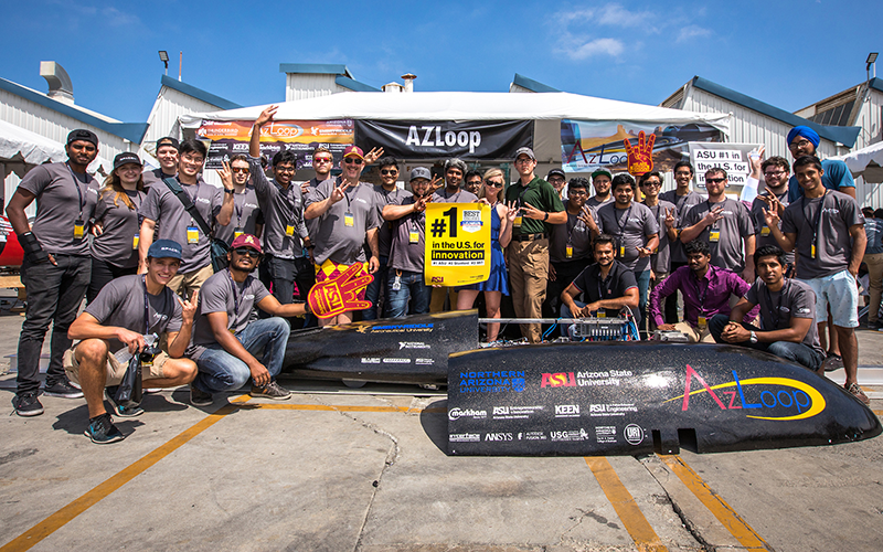 AZLoop team members pose with the pod for a group photo during the final round of the SpaceX Hyperloop Pod Competition on the SpaceX facilities in Hawthorne, California. (Photo courtesy of ASU Now)