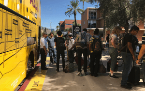 "AZLoop members get on a bus headed to Hawthorne, California. The team of Arizona students competed in a ""Hyperloop"" competition there on Sunday. (Photo by Samantha Pouls/Cronkite News)"
