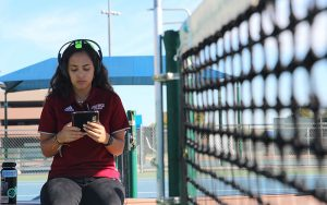 Ottawa University women's tennis player Hana Papaco concentrates on the 'focus' version of the Versus technology on Wednesday Jan. 17, 2018 in Surprise, Ariz. (Photo by Nicole Praga/Cronkite News)