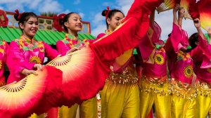 Students of Phoenix Wushu Academy perform a fan dance during the 28th annual Chinese Cultural and Cuisine Festival in Phoenix, telling stories and expressing emotion using fans to highlight their graceful movements. (Photo by Daria Kadovik/Cronkite News)