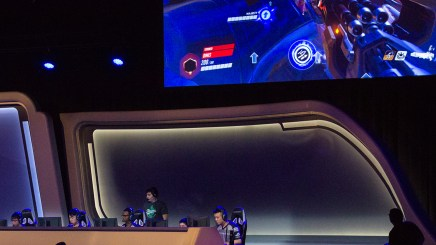 At the 2018 Fiesta Bowl Overwatch Collegiate National Championship, players compete while a large screen reflects the gameplay. (Photo by Miles Metke/Cronkite News)