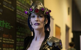 "Mary Brite, dressed as ""Widowmaker,"" is a professional prop maker in Phoenix. Many cosplay characters at the tournament were able to meet other versions of their own Overwatch game characters. (Photo by Miles Metke/Cronkite News)"