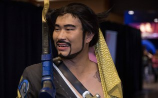 "Elin Xu, dressed as Overwatch character ""Hanzo,"",talked about the creative talent and ability cosplay requires. Hundreds of people filled the Sun Devil Fitness Center, with some dressed as characters from the game. (Photo by Miles Metke/Cronkite News)"