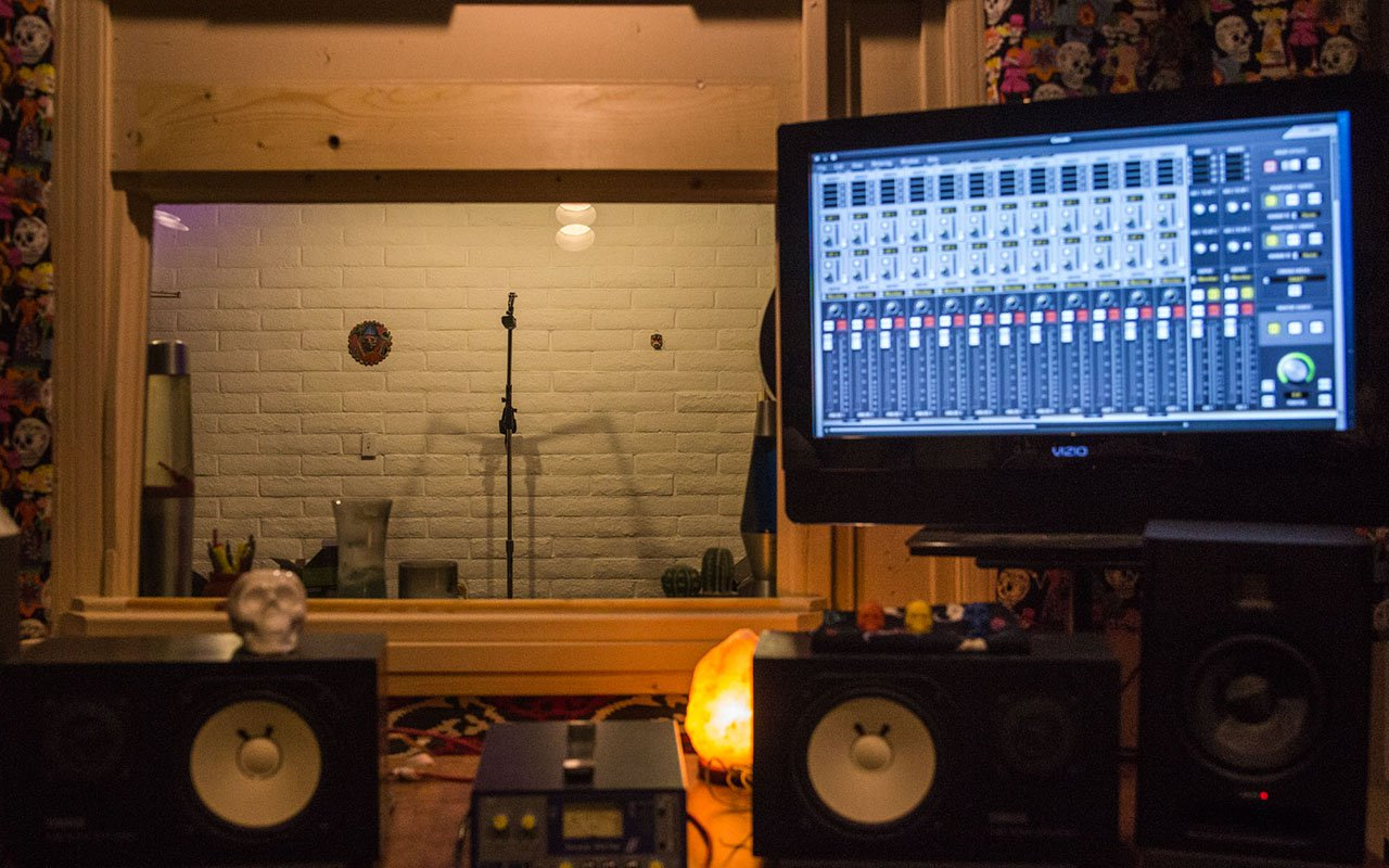 Tantillo shares his recording studio – originally a dentist office – with another audio engineer who uses this recording booth to record bands' albums. (Photo by Nicole Gimpl/Cronkite News)