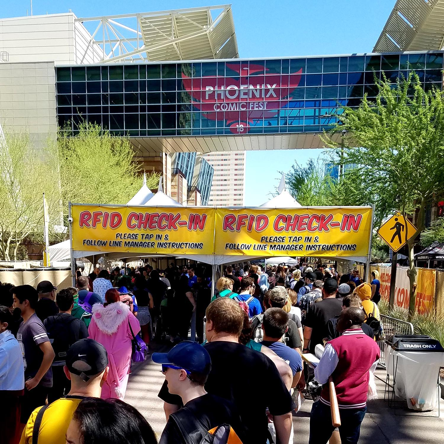 Attendees line up to check in on the second day of Phoenix Comic Fest, Friday, May 25, 2018, at the Phoenix Convention Center.