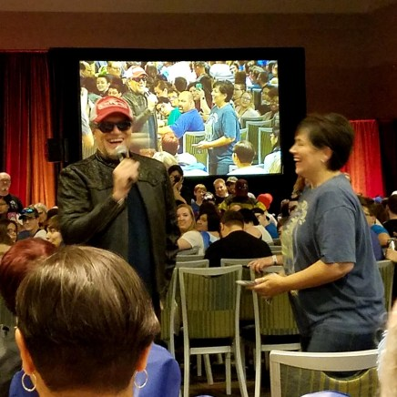 Michael Rooker laughs with a fan at Phoenix Comic Fest, Sunday, May 27, 2018, at the Phoenix Convention Center.