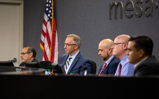 Mayor John Giles, center, listens to public comments about an ASU campus that will be built in downtown Mesa. (Photo by Ellen O'Brien/Cronkite News)