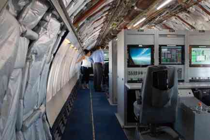 Instead of rows of passenger seats, cabinets packed with monitoring equipment are placed in a modified Boeing 757 plane used for test flights. (Photo by Nick Serpa/Cronkite News)