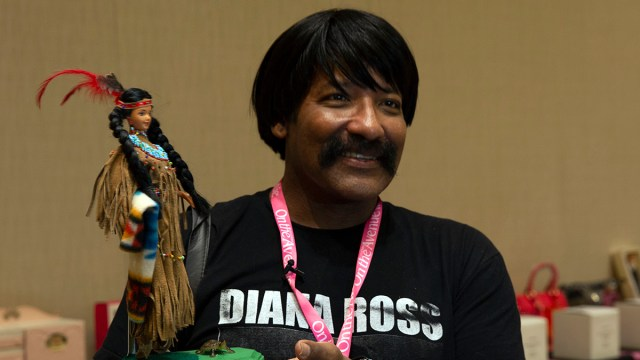 Pabboo Redfeather, a designer and artist who has been collecting Barbies since he was 5, started a black Barbie club in 1980. (Photo by Vivian Meza/Cronkite News)