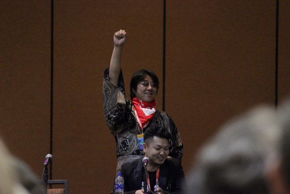 Arc System Works game designer Toshimichi Mori dances a long to a promo video during his panel.