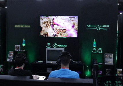 "The Geico Gaming booth hosted a ""play with the pros"" area where spectators could square off with professional players."