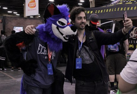 "Dominique ""SonicFox"" McLean poses with a fan during the tournament."