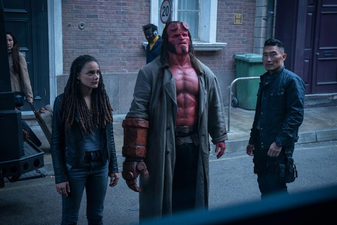 Alice Monaghan (Sasha Lane), Hellboy (David Harbour, center), and Ben Daimio (Daniel Dae Kim, right) in HELLBOY. Photo by: Mark Rogers.