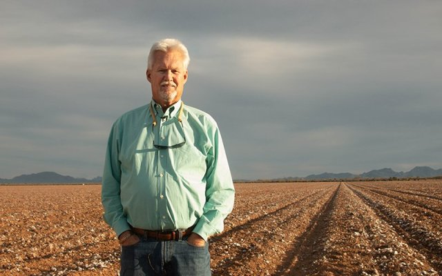 "Although Paul ""Paco"" Ollerton has spent almost his entire life on a cotton farm, he's considering growing hemp this summer. ""Even though I've been here 38 years, we (still) don't know everything about cotton."" (Photo by Meg Potter/Cronkite News)"