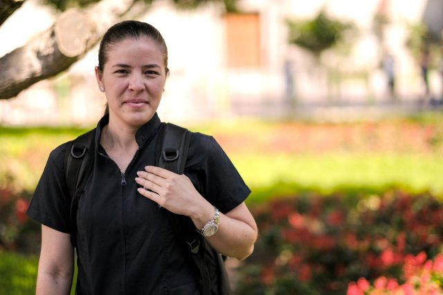 Mariangie Tarzona was a journalist in Venezuela and now lives in Lima. She says her phone is her lifeline to her family. (Photo by Chloe Jones/Cronkite Borderlands Project)