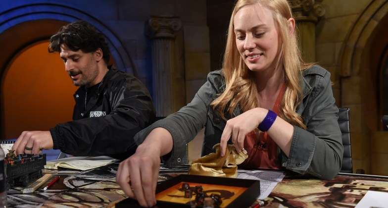"Joe Manganiello, left, and Deborah Ann Woll help unveil the Dungeons & Dragons storyline, ""Waterdeep: Dragon Heist"" during a live streaming event at the Line 204 Studios on Friday, June 1, 2018, in Los Angeles. (Jordan Strauss/AP Images for Dungeons & Dragons)"