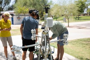 The MaRTy team prepares the instruments to record data in Tempe's Kiwanis Park, which will help them understand what types of trees and structures provide the best shade. (Photo by Dylan Simard/ Cronkite News)