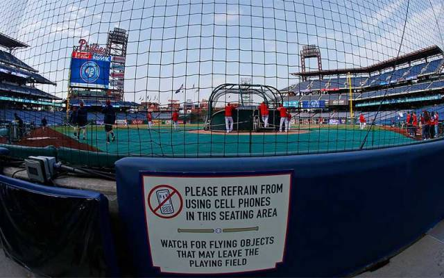 Warning signs, such as this one behind home plate at Citizens Bank Park in Philadelphia, are standard in MLB stadiums. (Photo by Rich Schultz/Getty Images)
