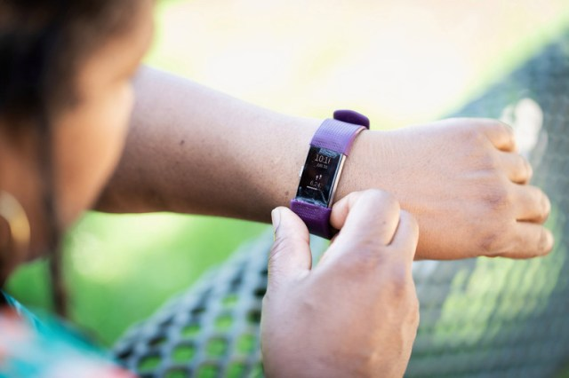 Sonia Anderson, 53, checks her Fitbit. A recent Harvard University study published in the Journal of the American Medical Association concluded that, among older women, as few as 4,400 steps per day helped to lower mortality rates.(SCOTT SUCHMAN FOR KHN)