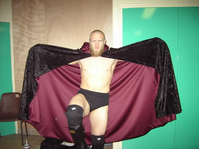 A picture of Bryan Danielson AKA Daniel Bryan with his beard and wizards cloak gimmick