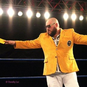 The ring announcer for CHIKARA, Vlad the Party Tsar in a lovely yellow jacket
