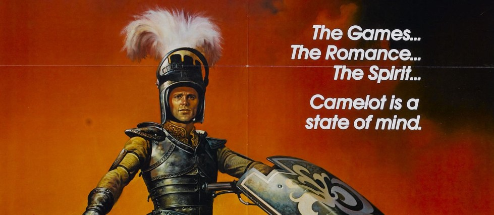 """The poster for Knightriders (1981) painting of Ed Harris shows him in his jousting armor and the text for the tagline: """"the games, the romance, the spirit, camelot is a state of mind"""""""
