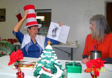 Iuka Librarian, Gwen Spain reads to the Crafty Crafters Knit & Crochet Group.