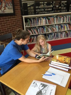 Reading together at the Corinth librarySnapshot Day at Iuka Library, August 6, 2019