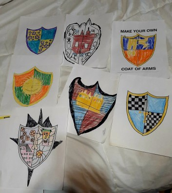 Cole got his family involved and they drew these awesome crests!
