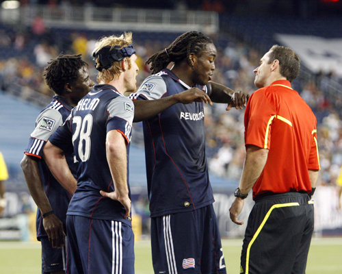Shalrie Joseph argues in vain against Paul Ward's penalty call. (Photo by CHRIS ADUAMA/aduama.com)