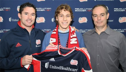 Scott Caldwell (middle) joins Revolution head coach Jay Heaps (left) and Revolution General Manager Mike Burns (right). (Photo credit: New England Revolution.)