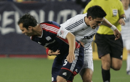 Revolution defender A.J. Soares battles with Whitecaps forward Omar Salgado in last year's clash, which Soares and his teammates won 4-1. (Photo: Tony Biscaia/Revsnet.com)
