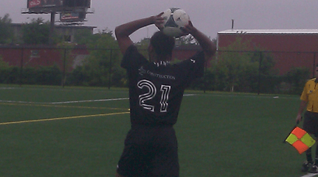 Fall River midfielder Andre Antunes gets set for a throw in during Sunday's contest against Safira FC.