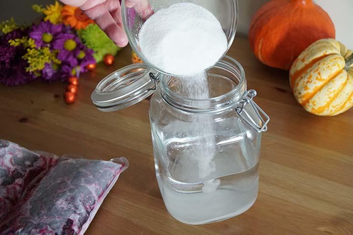 Adding sugar to the sloe gin potion