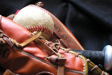 A baseball sits in a baseball mitt
