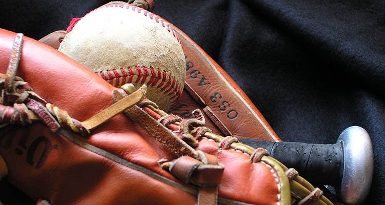 A baseball sits in a baseball mitt