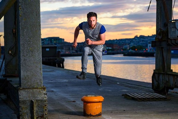 Jack is jumping over a boat anchor stump on the quays