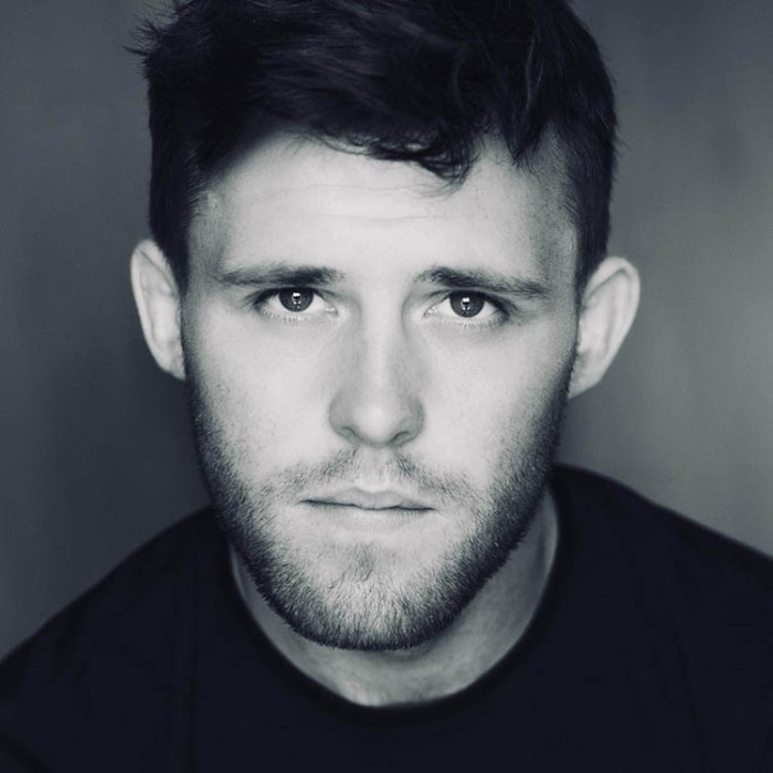 Niall McNamee black and white moody headshot