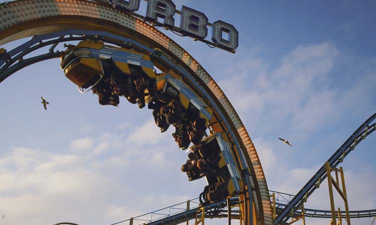 People upside down on a rollercoaster