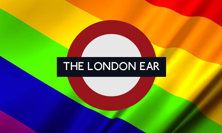 The London Ear roundel in front of a rainbow pride flag.