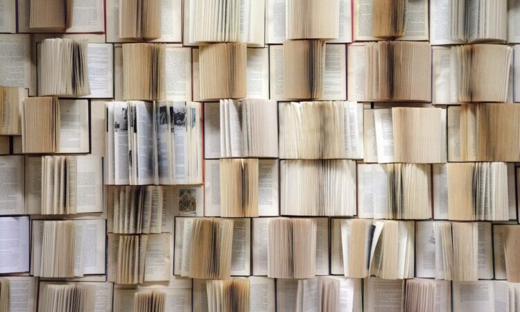 a wall of open books
