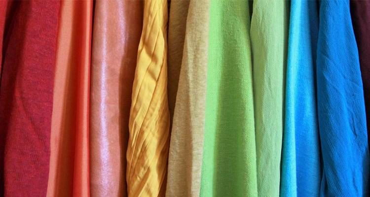 Rainbow fabric placed vertically like a LGBTQ flag